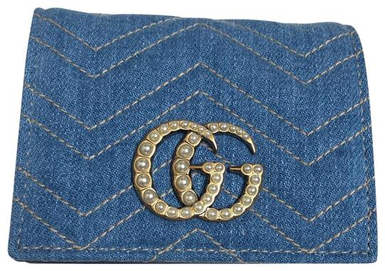 Preload https://img-static.tradesy.com/item/25836832/gucci-blue-marmont-limited-edition-quilted-denim-pearl-gg-small-flap-wallet-0-1-540-540.jpg