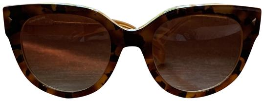Preload https://img-static.tradesy.com/item/25838575/prada-tan-sunglasses-0-1-540-540.jpg