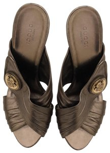 Gucci metallic bronze with gold logo Formal