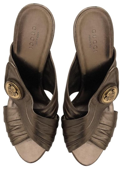 Preload https://img-static.tradesy.com/item/25839023/gucci-metallic-bronze-with-gold-logo-heels-formal-shoes-size-us-8-wide-c-d-0-1-540-540.jpg