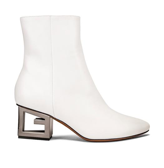 Preload https://img-static.tradesy.com/item/25839895/givenchy-white-triangle-heel-ankle-bootsbooties-size-eu-375-approx-us-75-regular-m-b-0-0-540-540.jpg