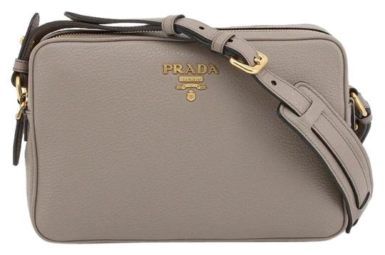 Preload https://img-static.tradesy.com/item/25841124/prada-saffiano-camera-argilla-grey-leather-cross-body-bag-0-1-540-540.jpg