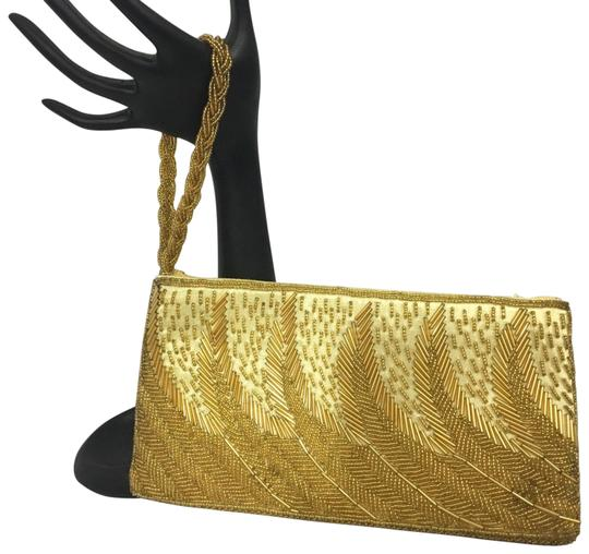 Preload https://img-static.tradesy.com/item/25845650/beaded-gold-satin-wristlet-0-1-540-540.jpg