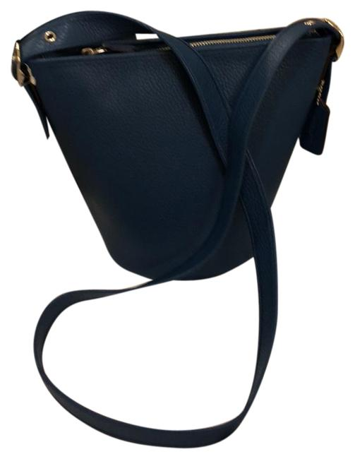 Item - Bucket Cross Body Blue with Silver Embellishments Leather Hobo Bag