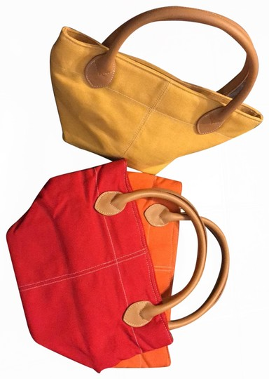 Preload https://img-static.tradesy.com/item/25858981/lillian-vernon-3-mini-canvas-with-leather-handles-red-yellow-orange-tote-0-2-540-540.jpg