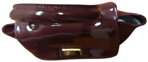 IACUCCI MADE IN ITALY Maroon Colored Small Clutch Clutch