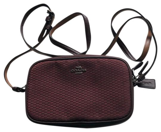 Preload https://img-static.tradesy.com/item/25859937/coach-wine-with-brown-stitching-cloth-and-leather-cross-body-bag-0-1-540-540.jpg