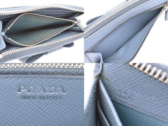 Prada Light Blue Bow Motif Saffiano Leather Zip Wallet Image 8