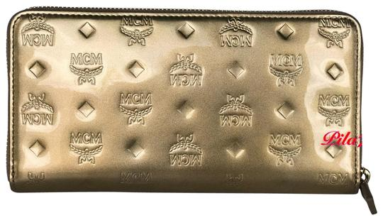 Preload https://img-static.tradesy.com/item/25865950/mcm-gold-new-wallet-embossed-patent-leather-0-1-540-540.jpg