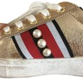 Skechers gold, black, red Athletic