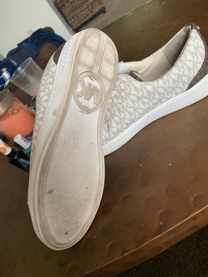 Preload https://item1.tradesy.com/images/michael-kors-white-irving-lace-up-sneakers-size-us-95-regular-m-b-25871695-0-0.jpg?width=440&height=440