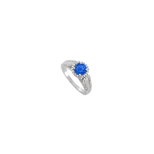 Preload https://img-static.tradesy.com/item/25871790/blue-sapphire-and-cz-halo-engagement-in-14k-white-gold-ring-0-0-540-540.jpg