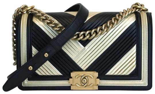 Preload https://img-static.tradesy.com/item/25879872/chanel-handbag-boy-metallic-medium-in-rome-flap-gold-black-calfskin-leather-cross-body-bag-0-1-540-540.jpg