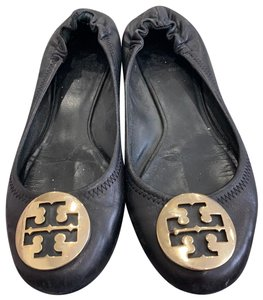 Tory Burch black and gold hardware ware. Flats