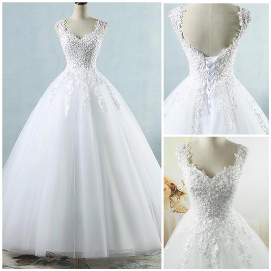 Preload https://img-static.tradesy.com/item/25884599/white-ivory-tulle-with-pearls-2-26w-or-customized-formal-wedding-dress-size-os-one-size-0-0-540-540.jpg