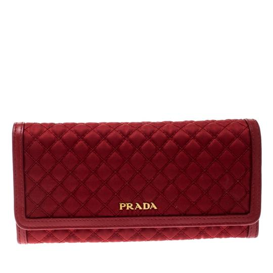 Preload https://img-static.tradesy.com/item/25886929/prada-red-quilted-nylon-and-leather-continental-flap-wallet-0-0-540-540.jpg
