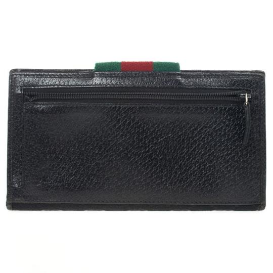 Gucci Black Continental Wallet With Engraved Gucci Script Logo Image 1