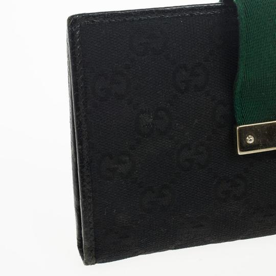 Gucci Black Continental Wallet With Engraved Gucci Script Logo Image 10