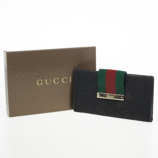 Gucci Black Continental Wallet With Engraved Gucci Script Logo Image 11