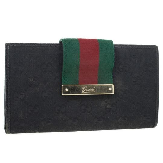 Gucci Black Continental Wallet With Engraved Gucci Script Logo Image 2