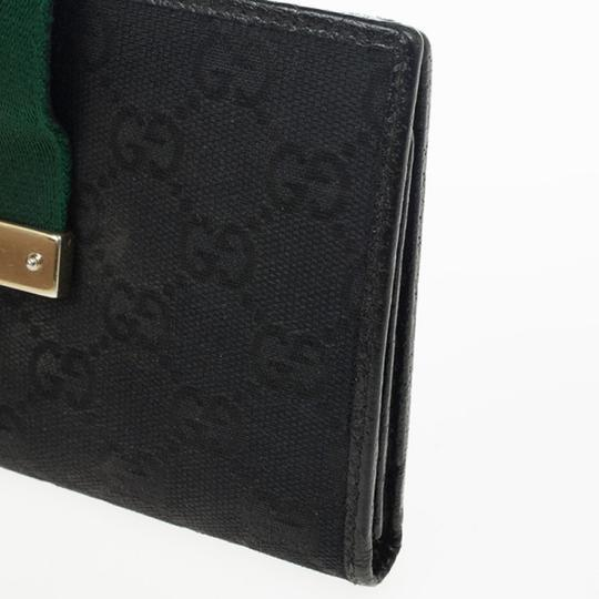 Gucci Black Continental Wallet With Engraved Gucci Script Logo Image 6