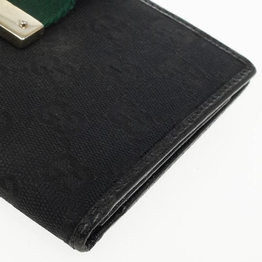 Gucci Black Continental Wallet With Engraved Gucci Script Logo Image 7