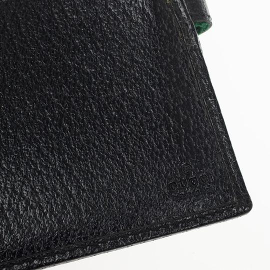 Gucci Black Continental Wallet With Engraved Gucci Script Logo Image 9