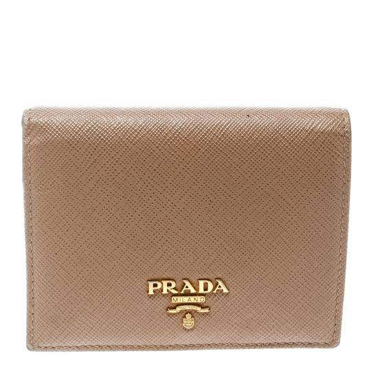 Preload https://img-static.tradesy.com/item/25892751/prada-brown-lux-light-saffiano-leather-bifold-wallet-0-0-540-540.jpg