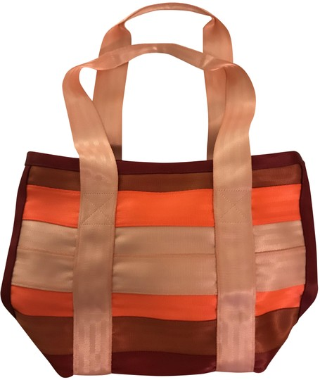 Preload https://img-static.tradesy.com/item/25897675/multicolored-striped-seatbelt-material-pink-red-and-orange-polyester-tote-0-1-540-540.jpg