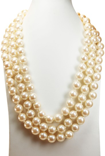 Preload https://img-static.tradesy.com/item/25899082/givenchy-cream-and-gold-triple-strand-white-pearl-choker-with-logo-clasp-necklace-0-1-540-540.jpg