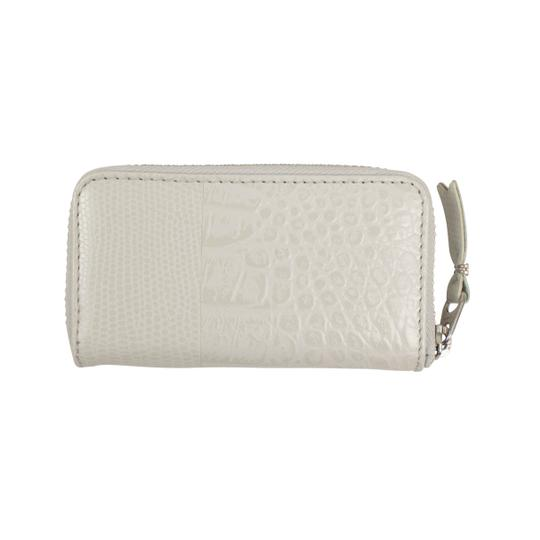 Preload https://img-static.tradesy.com/item/25904919/comme-des-garcons-gray-animal-embossed-patchwork-mini-coin-purse-wallet-0-0-540-540.jpg
