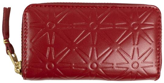 Preload https://img-static.tradesy.com/item/25909770/comme-des-garcons-red-leather-star-embossed-mini-coin-purse-wallet-0-1-540-540.jpg