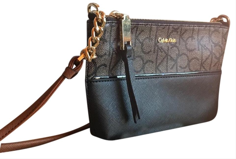 on feet shots of authorized site hot products Calvin Klein Hayden Signature Chain Strap Brown Khaki Luggage / Gold Faux  Leather Cross Body Bag 48% off retail