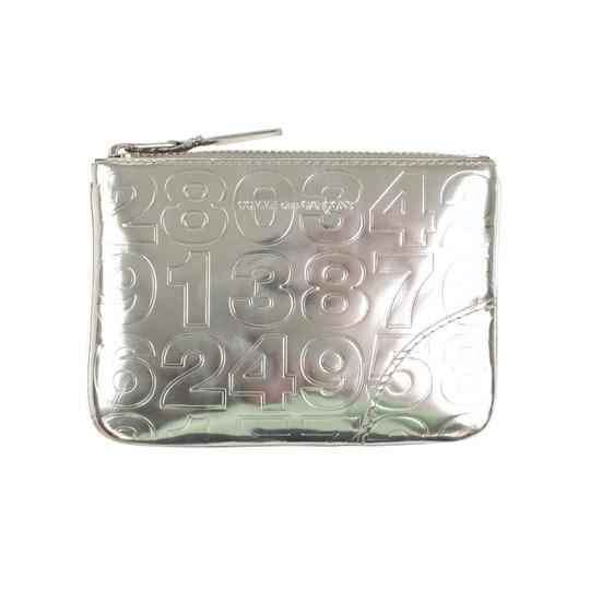 Preload https://img-static.tradesy.com/item/25909902/comme-des-garcons-silver-leather-number-embossed-pouch-wallet-0-0-540-540.jpg