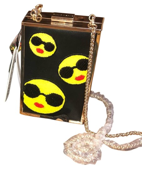 Preload https://img-static.tradesy.com/item/25914702/alice-olivia-sophia-embellished-northsouth-black-leather-clutch-0-1-540-540.jpg