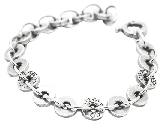 Preload https://img-static.tradesy.com/item/25914745/tiffany-and-co-silver-w-sterling-1837-circle-medium-size-725in-w-pouch-bracelet-0-3-540-540.jpg