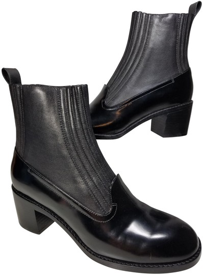 Preload https://img-static.tradesy.com/item/25914881/opening-ceremony-black-martaa-glossy-patent-leather-ankle-pull-on-bootsbooties-size-eu-39-approx-us-0-1-540-540.jpg