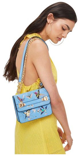 Preload https://img-static.tradesy.com/item/25915347/topshop-embroidered-light-blue-multi-canvas-shoulder-bag-0-1-540-540.jpg