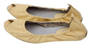 Cole Haan light yellow Flats
