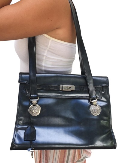 Preload https://img-static.tradesy.com/item/25918860/versace-shoulder-black-pearlysilvery-patent-leather-tote-0-3-540-540.jpg