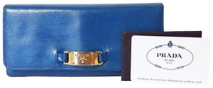 Prada Metallic blue leather trifold snap wallet with logo plate