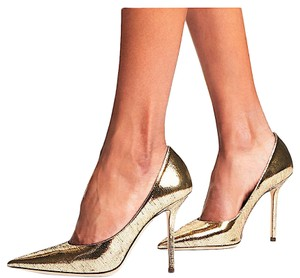 Jimmy Choo gold with tag Pumps
