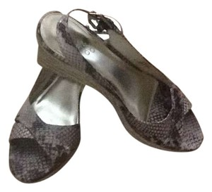 Franco Sarto Slingback's Franco Sarto. Scandals Brown Faux Snakeskin Wedges