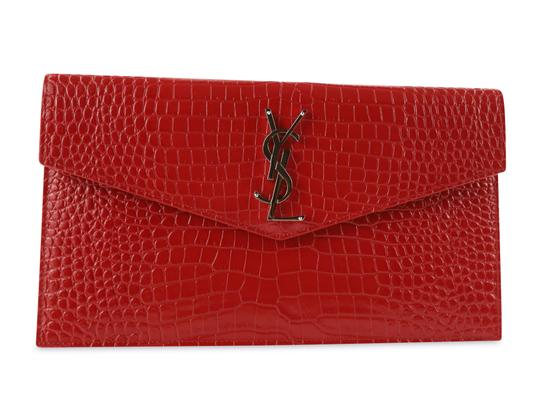 Preload https://img-static.tradesy.com/item/25920781/saint-laurent-uptown-croc-effect-patent-leather-pouch-red-calfskin-leather-clutch-0-1-540-540.jpg