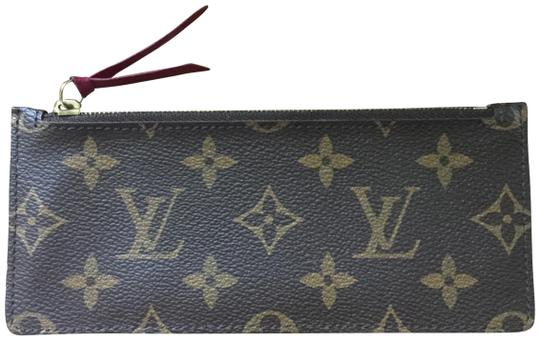 Preload https://img-static.tradesy.com/item/25923170/louis-vuitton-fuchsia-monogram-zipper-insert-wallet-0-4-540-540.jpg