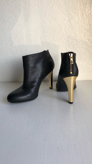 Tory Burch Black and Gold Boots Image 2