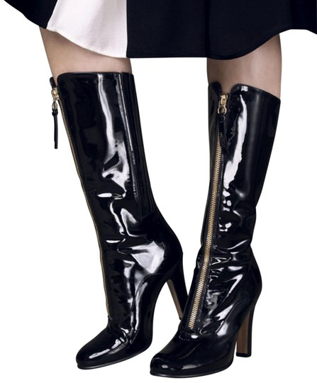 Preload https://img-static.tradesy.com/item/25932514/valentino-black-rebelle-patent-leather-front-zip-euro-85-bootsbooties-size-eu-39-approx-us-9-regular-0-1-540-540.jpg