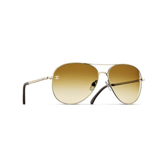 Preload https://img-static.tradesy.com/item/25935215/chanel-gold-ch-4189tq-c3954n-59mm-titanium-aviator-sunglasses-0-0-540-540.jpg