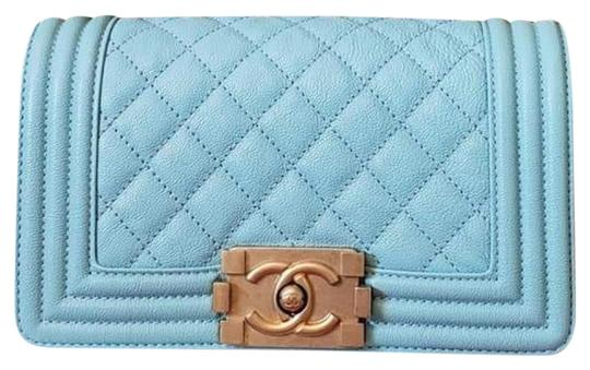 Preload https://img-static.tradesy.com/item/25946128/chanel-classic-flap-boy-2019-le-small-caviar-gold-hw-blue-patent-leather-shoulder-bag-0-2-540-540.jpg