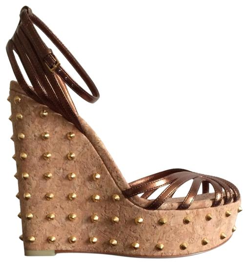 Preload https://img-static.tradesy.com/item/25946581/gucci-brown-copper-leather-studded-wedges-size-eu-375-approx-us-75-regular-m-b-0-3-540-540.jpg
